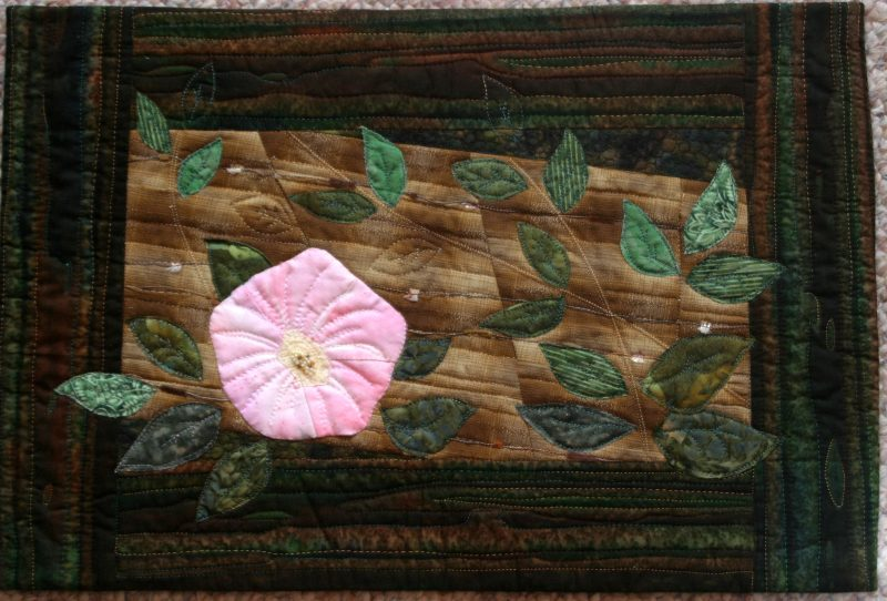 Morning glory, log, vine, nature, Huntley Meadows, machine quilted, machine applique